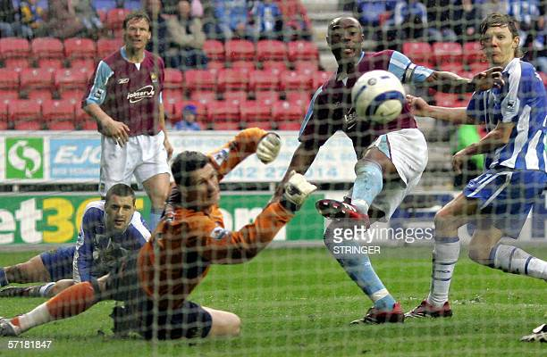 West Ham United's Nigel ReoCoker scores past Mike Pollitt in the Wigan Athletic goal during their English Premiership soccer match at The JJB Stadium...
