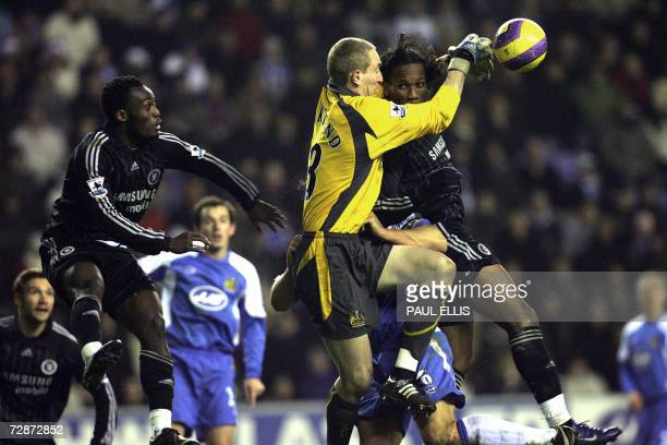 Wigan Athletic goalkeeper Chris Kirkland rises to save a header from Chelsea's Didier Drogba of Ivory Coast during their English Premiership football...