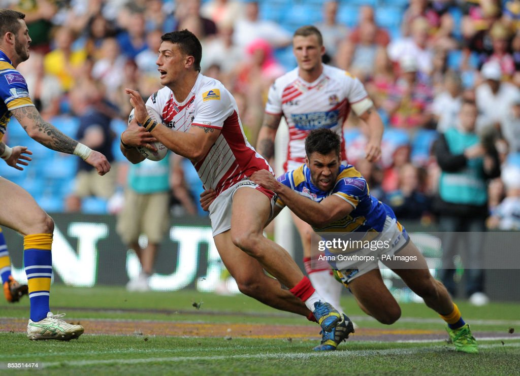 Wigan Warriors' Anthony Gelling is tackled by Leeds Rhinos' Joel Moon during the First Utility Super League Magic Weekend match at the Etihad Stadium, Manchester.