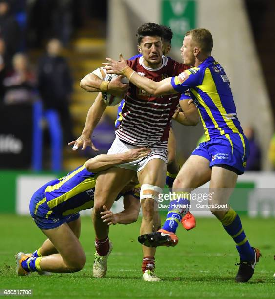 Wigan Warriors' Anthony Gelling is tackled during the Betfred Super League Round 4 match between Warrington Wolves and Wigan Warriors at the...