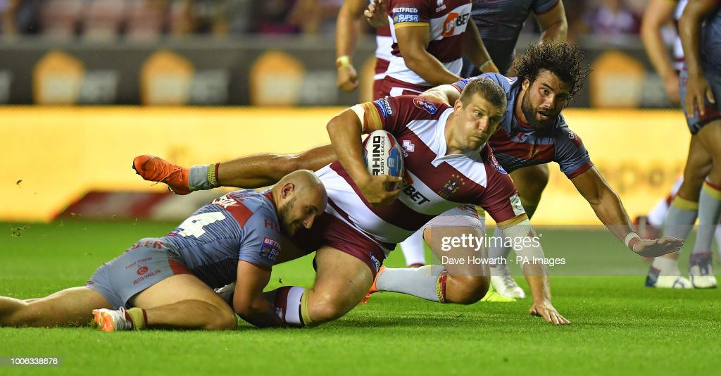 Wigan Warriors' Ben Flower is tackled during the Betfred Super League match at the DW Stadium, Wigan.