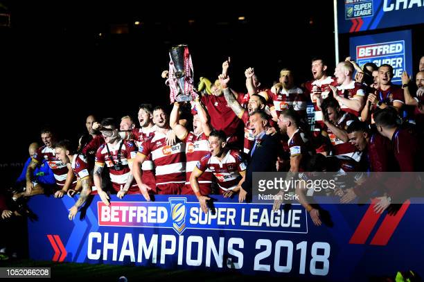 Wigan Warriors celebrate with the trophy following victory in the BetFred Super League Grand Final between Warrington Wolves and Wigan Warriors at...