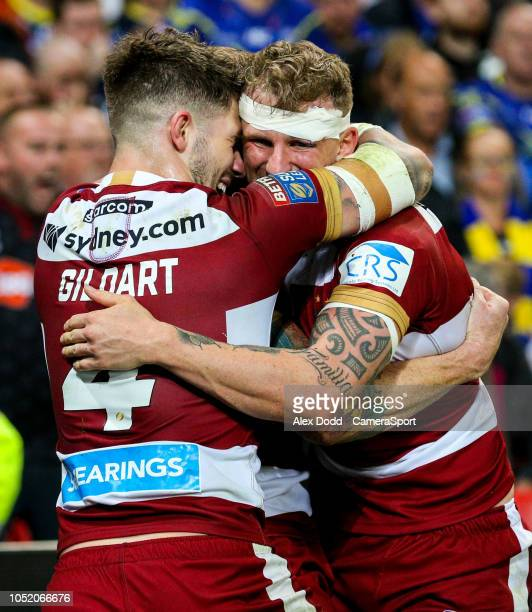 Wigan Warriors' Dominic Manfredi celebrates scoring his side's third try with Oliver Gildart during the Betfred Super League Grand Final match...