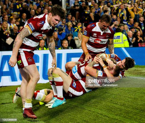 Wigan Warriors' Dominic Manfredi is mobbed after scoring a late try during the Betfred Super League Grand Final match between Wigan Warriors and...