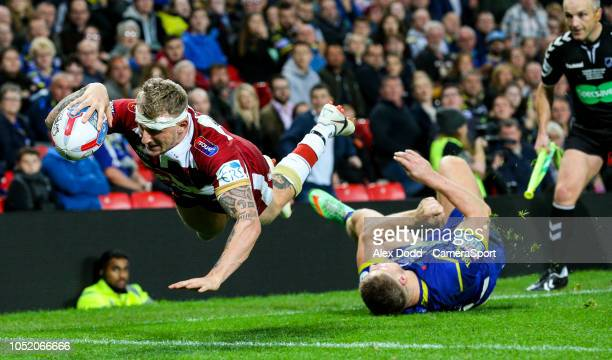 Wigan Warriors' Dominic Manfredi scores his side's third try during the Betfred Super League Grand Final match between Wigan Warriors and Warrington...