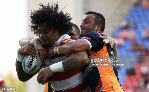 Wigan Warrior's Epalahame Lauaki and Hull KR's Josh Hodgson during the Super League match at the DW Stadium Wigan