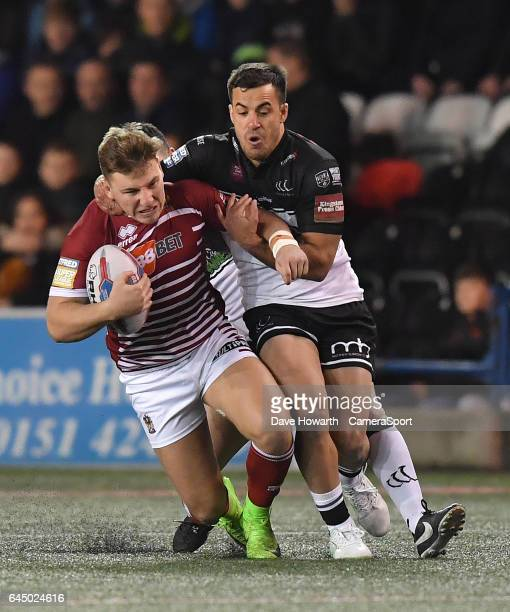 Wigan Warriors' George Williams is tackled by Corey Thompson during the Betfred Super League Round 2 match between Widnes Vikings and Wigan Warriors...