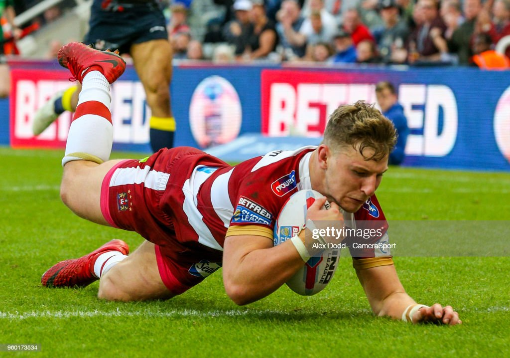 Wigan Warriors' George Williams scores his side's fourth try during the Betfred Super League Round 15 match between Wigan Warriors and Warrington Wolves at St James' Park on May 19, 2018 in Newcastle upon Tyne, England.