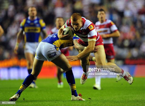 Wigan Warriors' Jack Hughes is tackled by Leeds Rhinos' Zak Hardaker during the Super League SemiFinal match at the DW Stadium Wigan