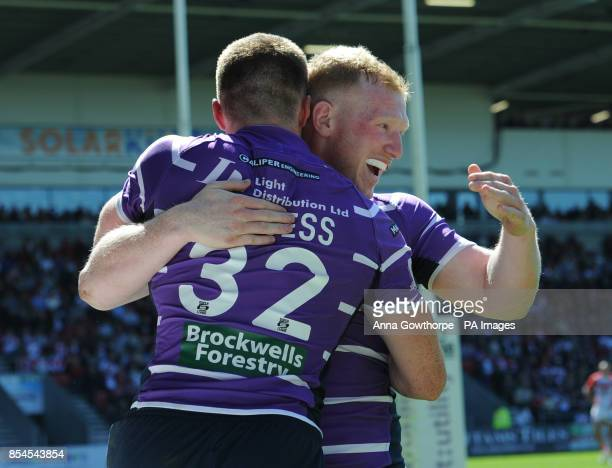 Wigan Warriors' Joe Burgess celebrates with Liam Farrell after scoring a try during the First Utility Super League match at Langtree Park St Helens