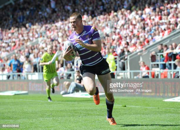 Wigan Warriors' Joe Burgess runs clear to score a try during the First Utility Super League match at Langtree Park St Helens