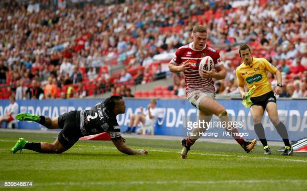 Wigan Warriors' Joe Burgess scores his side's third try during the Ladbrokes Challenge Cup Final at Wembley Stadium London
