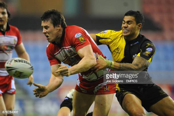 Wigan Warriors' Joel Tomkins and Celtic Crusaders' Frank Winterstein