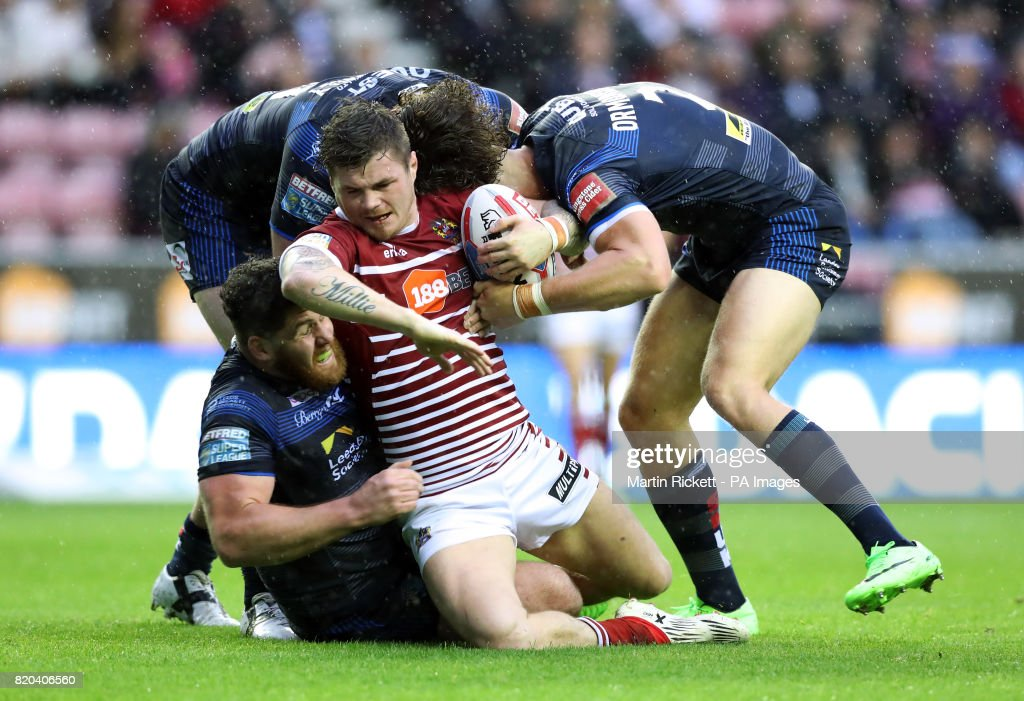 Wigan Warriors' John Bateman is tackled by Leeds Rhinos' Jack Ormondroyd (right) during the Betfred Super League match at DW Stadium, Wigan.