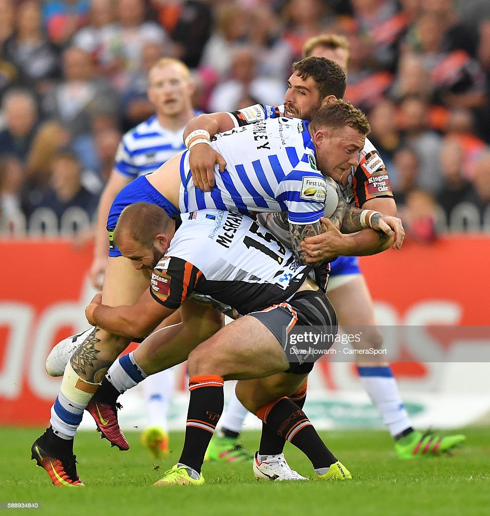 Wigan Warriors' Josh Charnley is tackled by Castleford Tigers' Paul McShane during the First Utility Super League Super 8s Round 2 between Castleford Tigers and Wigan Warriors at the Mend-A-Hose Jungle Stadium on August 12 in Castleford, England.