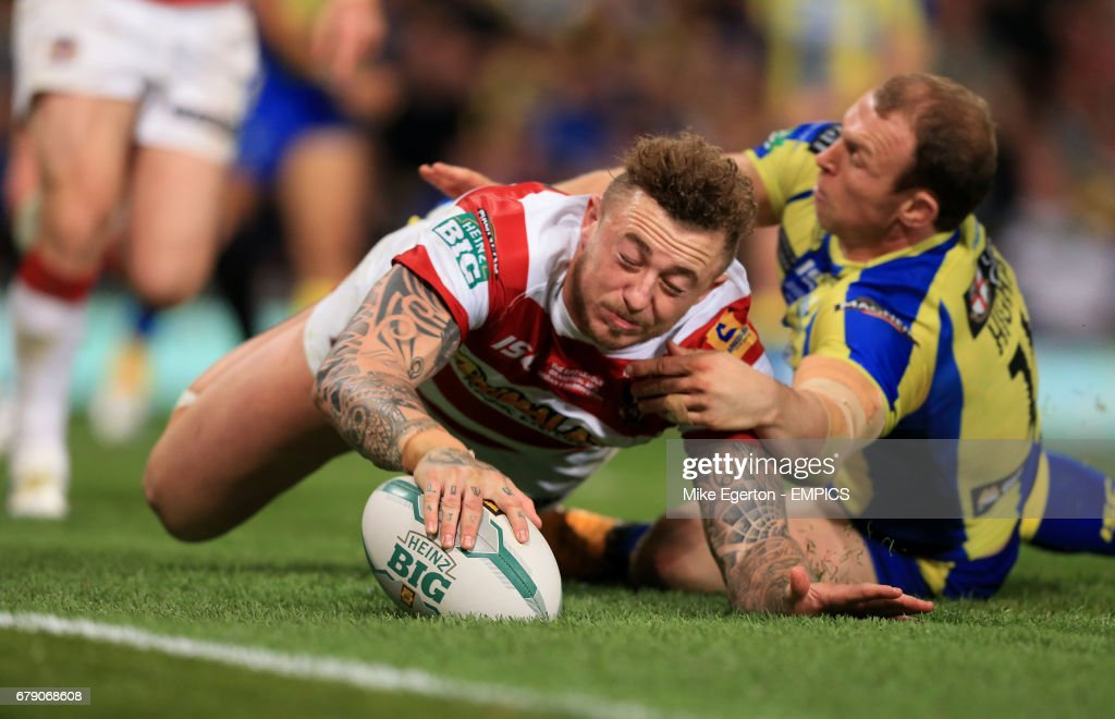 Wigan Warriors' Josh Charnley races clear to score a try