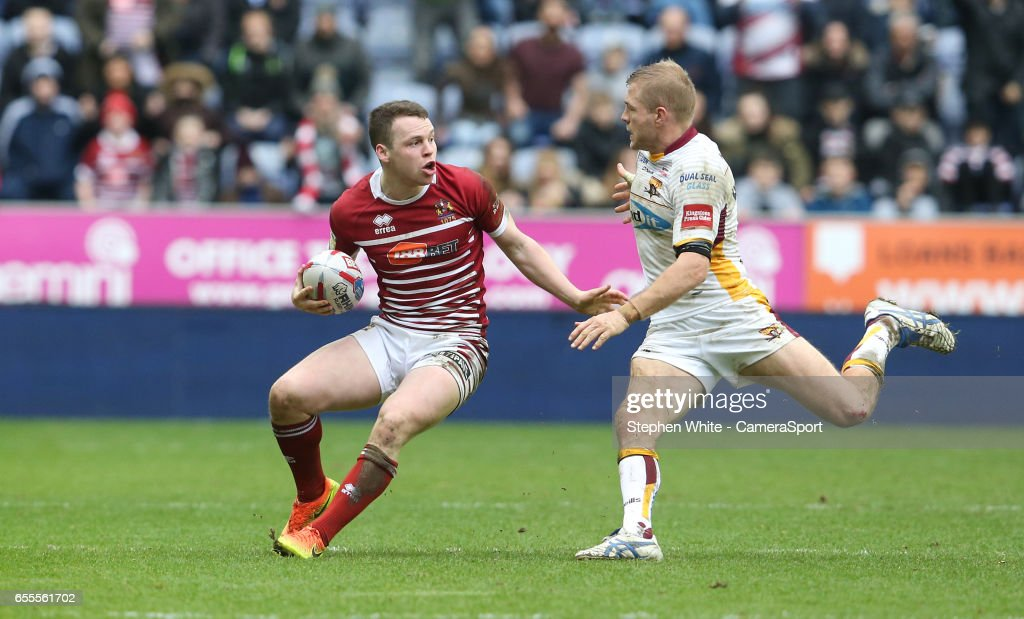 Wigan Warriors' Liam Marshall and Huddersfield Giants' Ryan Hinchcliffe during the Betfred Super League Round 5 match between Wigan Warriors and Huddersfield Giants at DW Stadium on March 19, 2017 in Wigan, England.