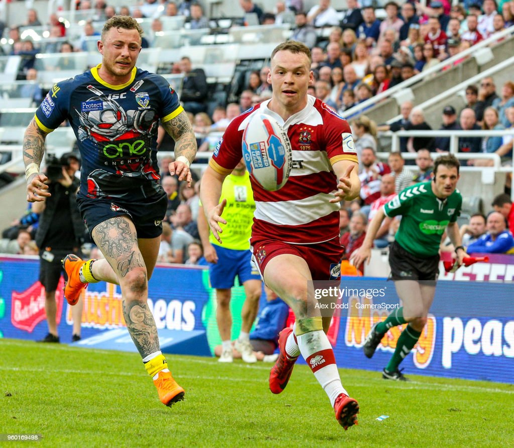 Wigan Warriors' Liam Marshall beats Warrington Wolves' Josh Charnley on the way to scoring his side's fifth try during the Betfred Super League Round 15 match between Wigan Warriors and Warrington Wolves at St James' Park on May 19, 2018 in Newcastle upon Tyne, England.