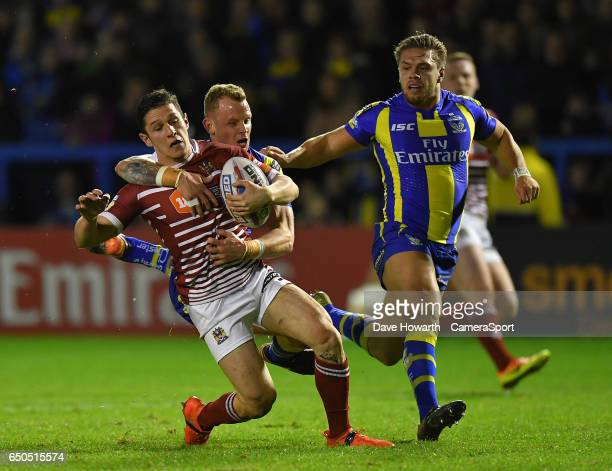 Wigan Warriors' Morgan Escare is tackled by Warrington Wolves' Kevin Brown during the Betfred Super League Round 4 match between Warrington Wolves...