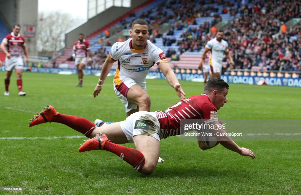 Wigan Warriors' Morgan Escare scores his sides first try during the Betfred Super League Round 5 match between Wigan Warriors and Huddersfield Giants at DW Stadium on March 19, 2017 in Wigan, England.