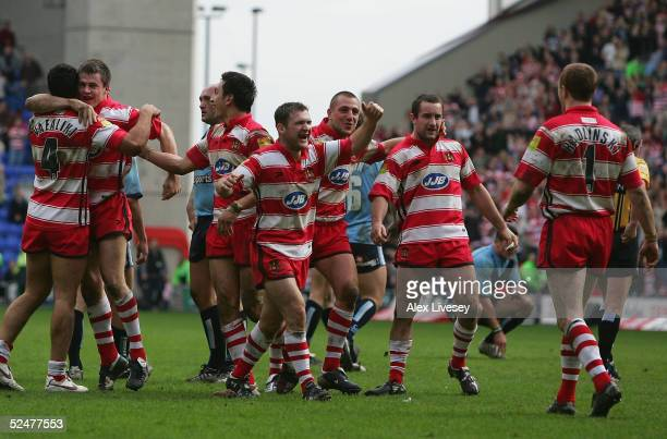 Wigan Warriors players celebrate victory over St Helens after the Super League match between Wigan Warriors and St Helens at the JJB Stadium on March...