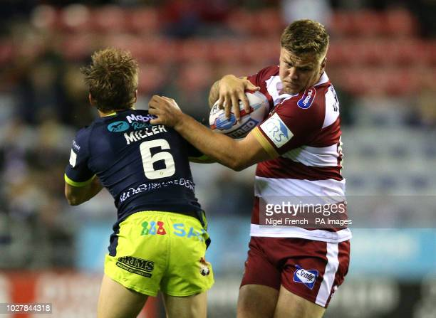Wigan Warriors' Ryan Sutton is tackled by Wakefield Trinity's Jacob Miller during the Betfred Super League Super 8's match at the DW Stadium Wigan
