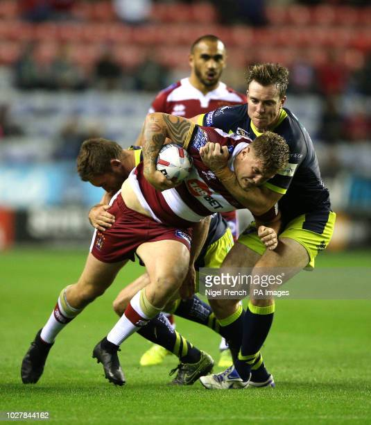 Wigan Warriors' Ryan Sutton is tackled by Wakefield Trinity's Matty Ashurst during the Betfred Super League Super 8's match at the DW Stadium Wigan