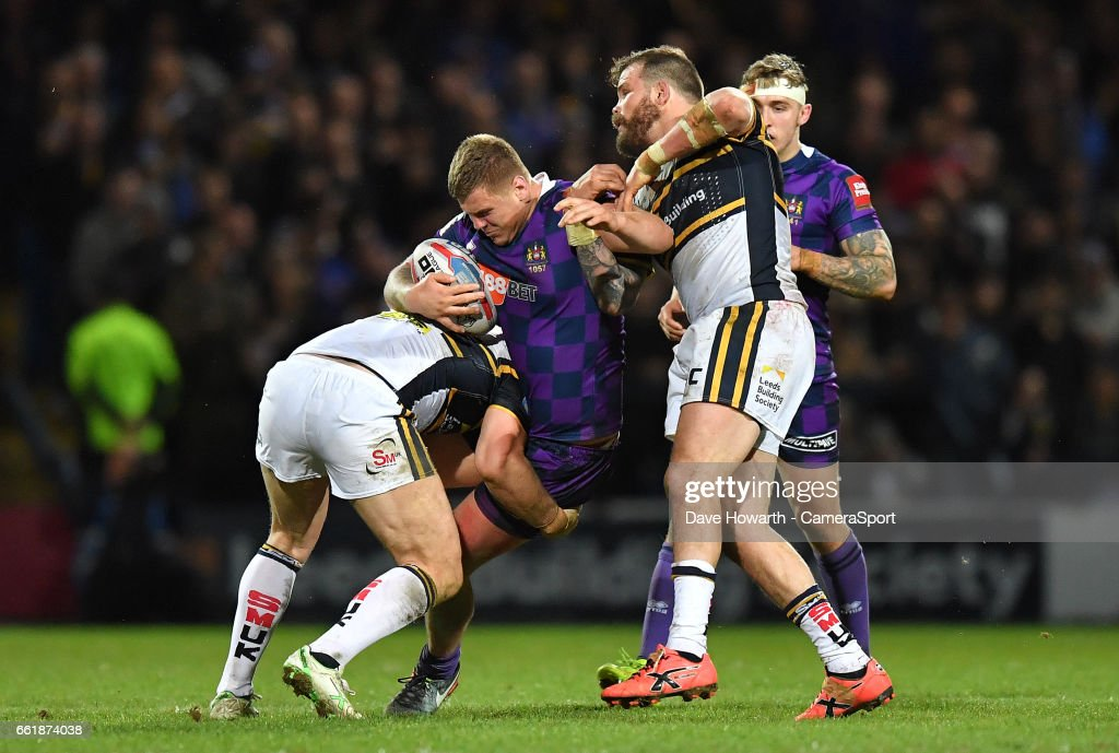 Wigan Warriors' Ryan Sutton is tackled during the Betfred Super League Round 7 match between Leeds Rhinos and Wigan Warriors at Headingley Carnegie Stadium on March 31, 2017 in Leeds, England.
