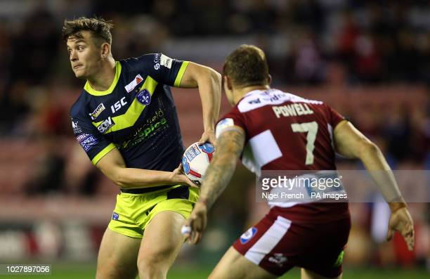 Wigan Warriors' Sam Powell and Wakefield Trinity Jordan Crowther during the Betfred Super League Super 8's match at the DW Stadium Wigan