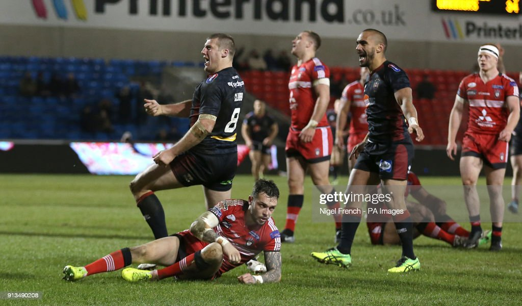 Wigan Warriors Tony Club celebrates as he runs in his sides seventh try during the Betfred Super League match at the AJ Bell Stadium, Salford.