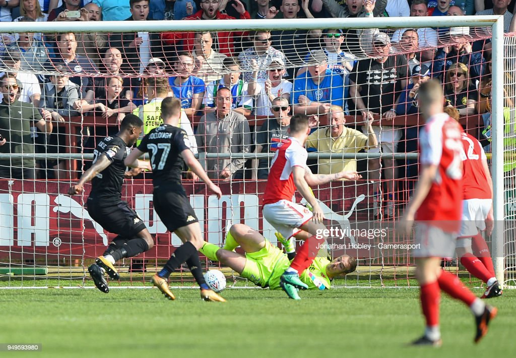 Wigans Cheyenne Dunkley scores his sides third goal goal past Fleetwood's Alex Cairns during the Sky Bet League One match between Fleetwood Town and Wigan Athletic at Highbury Stadium on April 21, 2018 in Fleetwood, England.