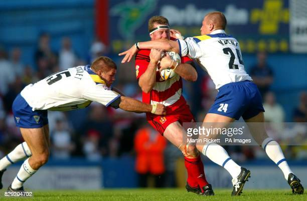 Wigan's David Furner is tackled by Warrington's Paul Marquet and Paul Noone during the Tetley's Bitter Super League match at Wilderspool stadium...