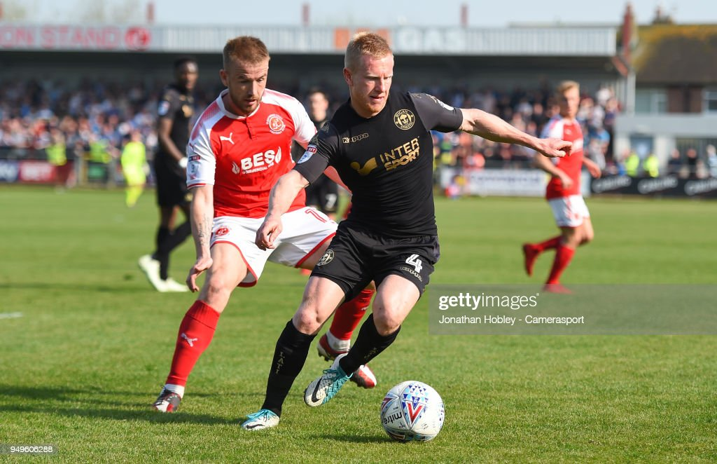 Wigans David Perkins holds off Fleetwood's Paddy Madden during the Sky Bet League One match between Fleetwood Town and Wigan Athletic at Highbury Stadium on April 21, 2018 in Fleetwood, England.