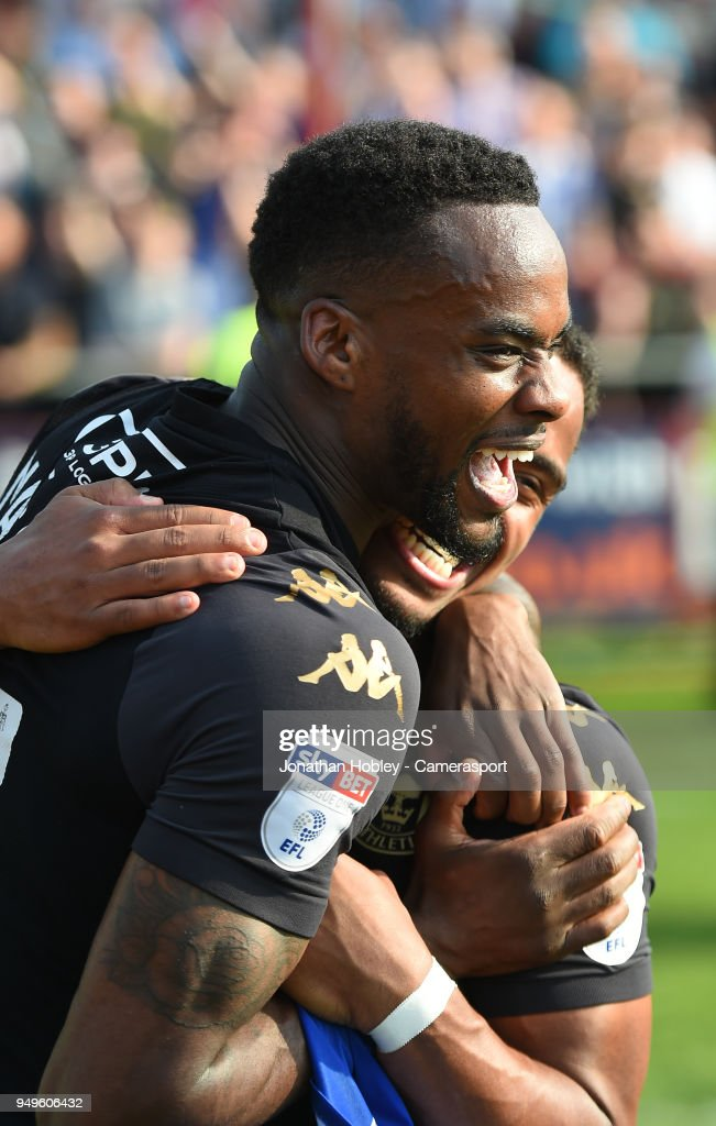Wigan's Gavin Massey celebrates after securing promotion to the Championship during the Sky Bet League One match between Fleetwood Town and Wigan Athletic at Highbury Stadium on April 21, 2018 in Fleetwood, England.