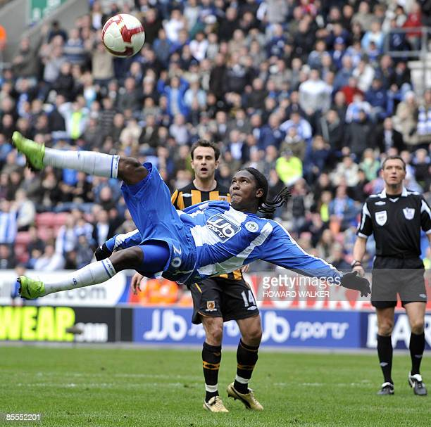 Wigan's Hugo Rodallego kicks the ball during their English Premiership football match against Hull at The JJB Stadium, north-west England on March...