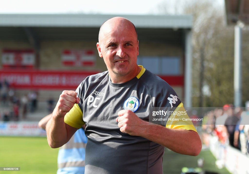 Wigans manager Paul Cook celebrates after securing promotion to the Championship during the Sky Bet League One match between Fleetwood Town and Wigan Athletic at Highbury Stadium on April 21, 2018 in Fleetwood, England.