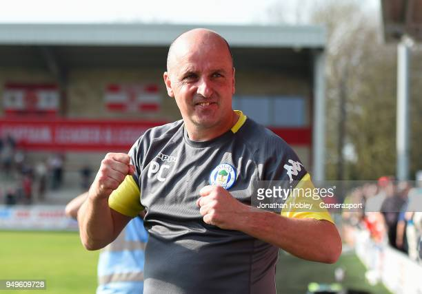 Wigans manager Paul Cook celebrates after securing promotion to the Championship during the Sky Bet League One match between Fleetwood Town and Wigan...