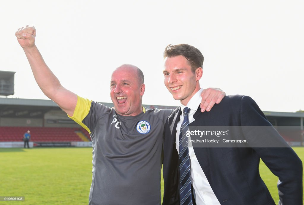 Wigan's manager Paul Cook with chairman David Sharke after securing promotion to the Championship during the Sky Bet League One match between Fleetwood Town and Wigan Athletic at Highbury Stadium on April 21, 2018 in Fleetwood, England.