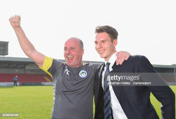 Wigan's manager Paul Cook with chairman David Sharke after securing promotion to the Championship during the Sky Bet League One match between...
