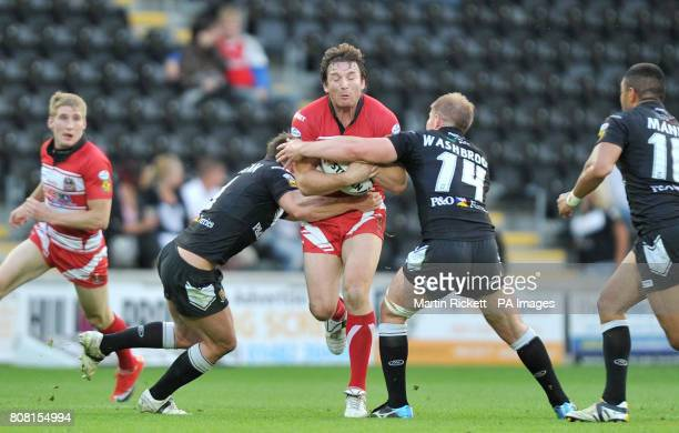 Wigans Martin Gleeson is tackled by Hull FC's Shaun Berrigan and Danny Washbrook during the Engage Super League match at the KC Stadium Hull