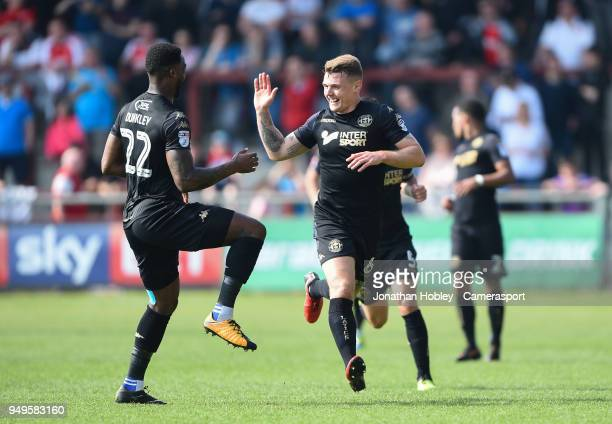 Wigan's Max Power celebrates scoring his side's first goal during the Sky Bet League One match between Fleetwood Town and Wigan Athletic at Highbury...