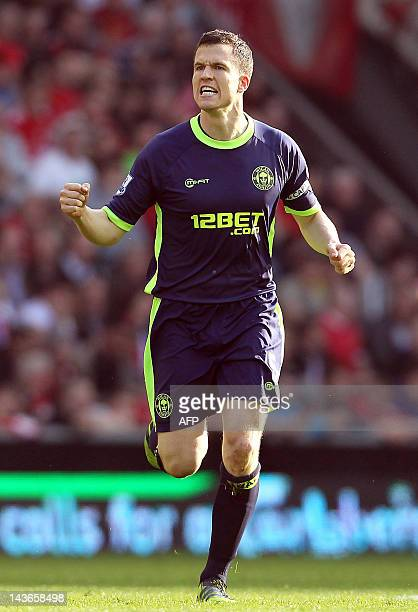 Wigan's Scottish defender Gary Caldwell celebrates scoring their second goal of the English Premier League football match between Liverpool and Wigan...