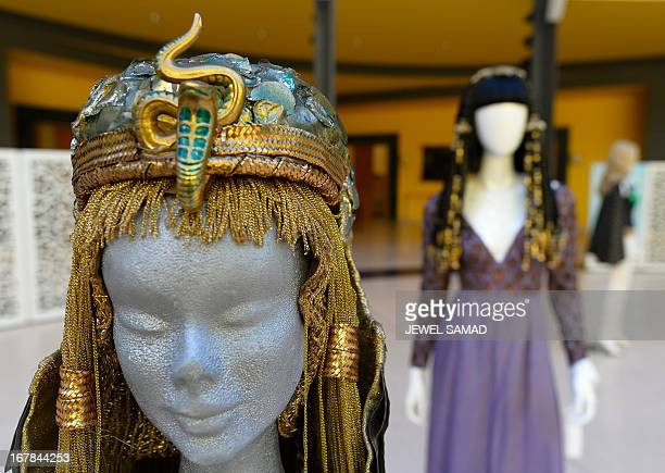 Wigs and dresses worn by actress Elizabeth Taylor in 1963 film Cleopatra are displayed during an exhibition at the Italian embassy in Washington, DC,...