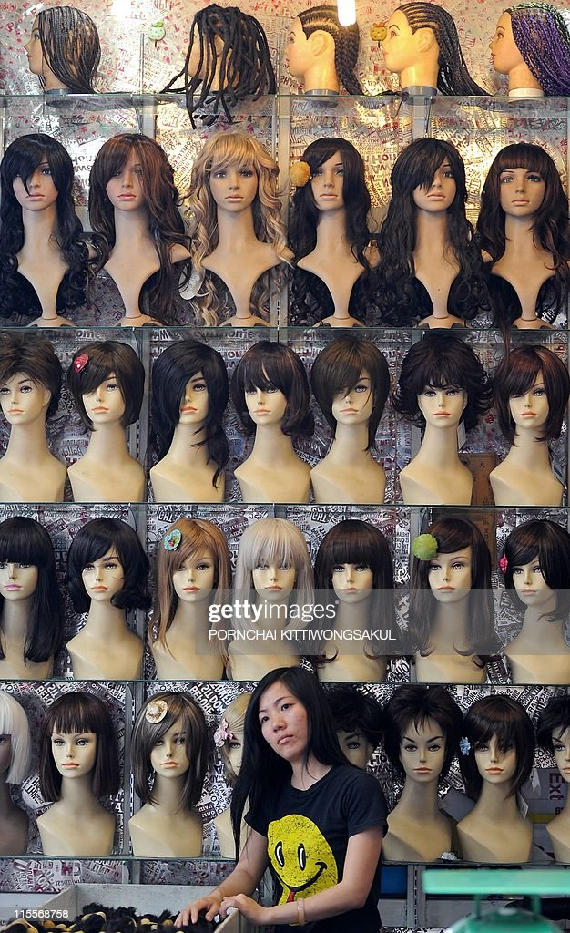 88043d5f7 Wigs are displayed at a shop in Bangkok on June 6, 2011. The Thai ...