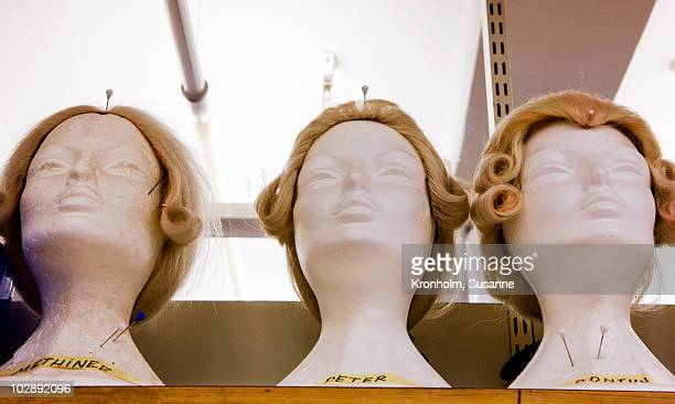 Wigs displayed on mannequin