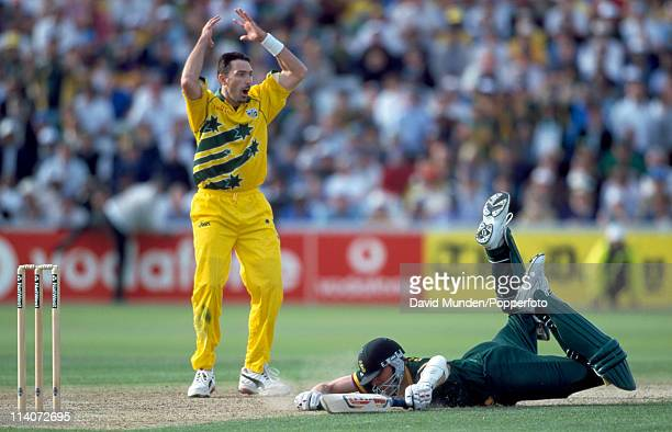 Wih the scores level Allan Donald of South Africa narrowly avoids being run out watched by Damien Fleming of Australia during the World Cup SemiFinal...