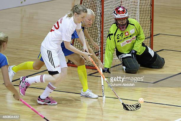 Wijk Anna of Sweden and Christine Zimmermann of Switzerland challenge for the ball during the World University Championship Floorball match between...