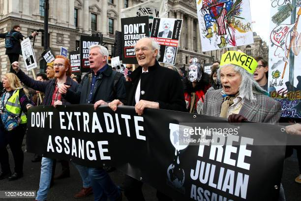 Wikileaks editorinchief Kristinn Hrafnsson Julian Assange's father John Shipton and fashion designer Vivienne Westwood march together on February 22...