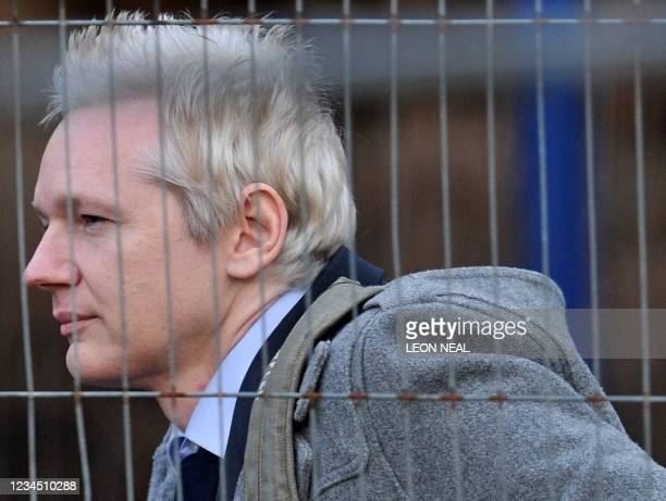 WikiLeaks founder Julian Assange arrives at Belmarsh Magistrates' Court, sitting at Woolwich Crown Court in south-east London, on January 11, 2011....