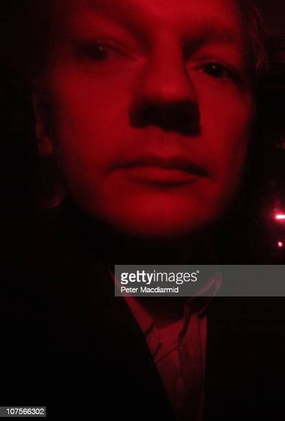 Wikileaks founder Julian Assange arrives at Westminster Magistrates Court inside a prison van with red windows on December 14, 2010 in London,...